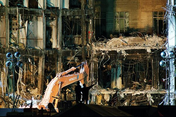 Rescue workers work late on 18 September 2001 in Washington, DC, sifting through piles of debris from the section of the Pentagon hit by the terrorist attack 11 September - Sputnik International