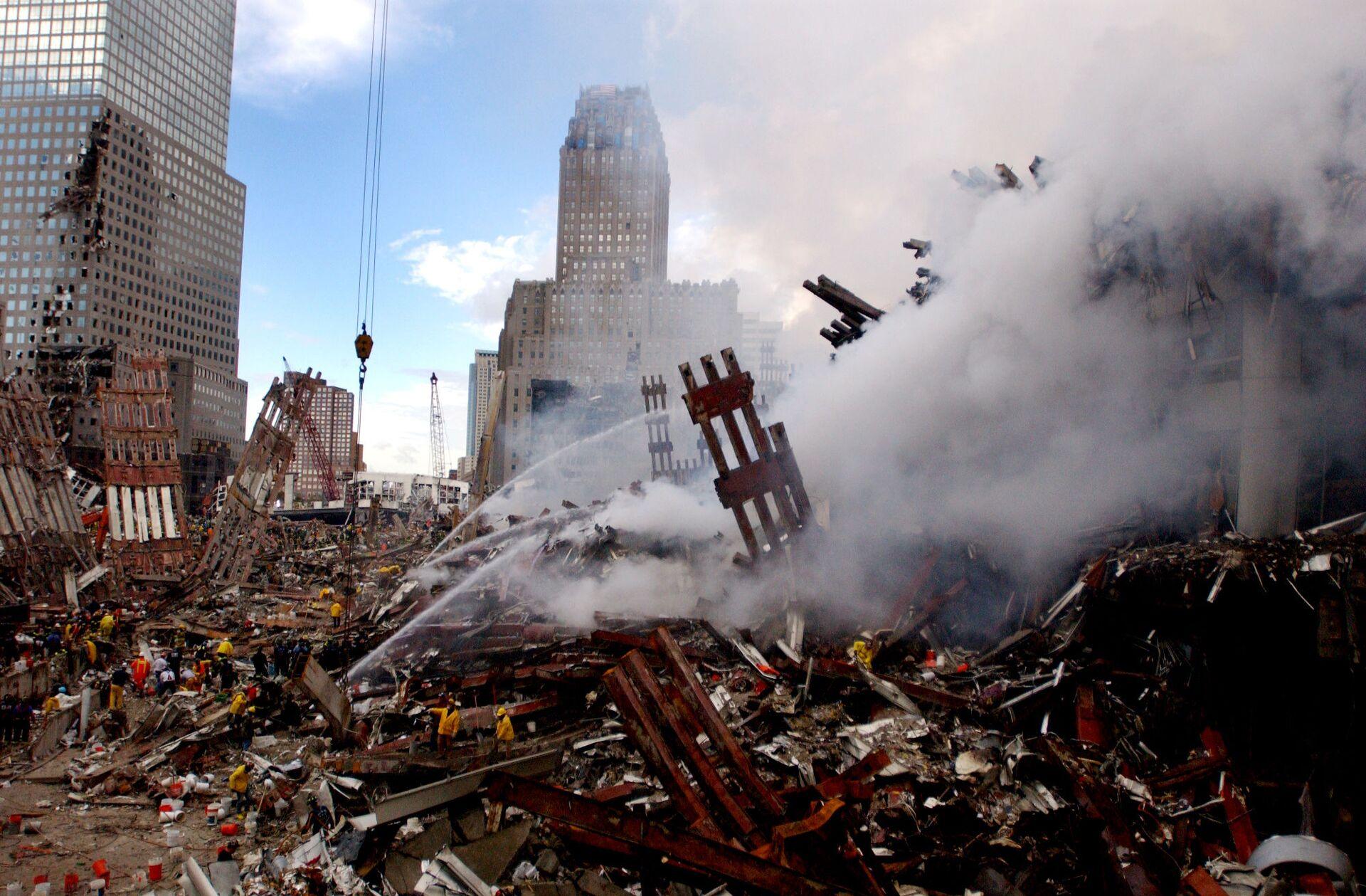 Fires still burn amidst the rubble of the World Trade Center, days after the 11 September terrorist attack. - Sputnik International, 1920, 07.09.2021