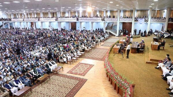In this handout file photo taken on August 9, 2020 and released by the Press Office of President of Afghanistan, Afghan people attend on the last day of the Loya Jirga, a grand assembly, at the Loya Jirga Hall in Kabul. - Sputnik International