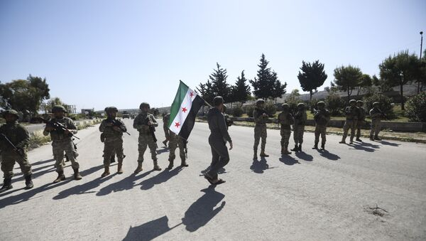 A man carries Syrian Independence flag as Turkish soldiers block a road after a nearby explosion outside the city of Ariha, in Idlib province, Syria, Tuesday, May 12, 2020 - Sputnik International
