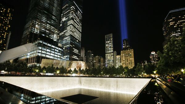 The Tribute in Light is seen in the sky above the National September 11 Memorial at the World Trade Center site on the 16th anniversary of the Sept. 11 terror attacks, Monday, Sept. 11, 2017, in New York. Two giant towers of light have lit up the lower Manhattan skyline as a visual memorial to those who lost their lives on 9/11 - Sputnik International