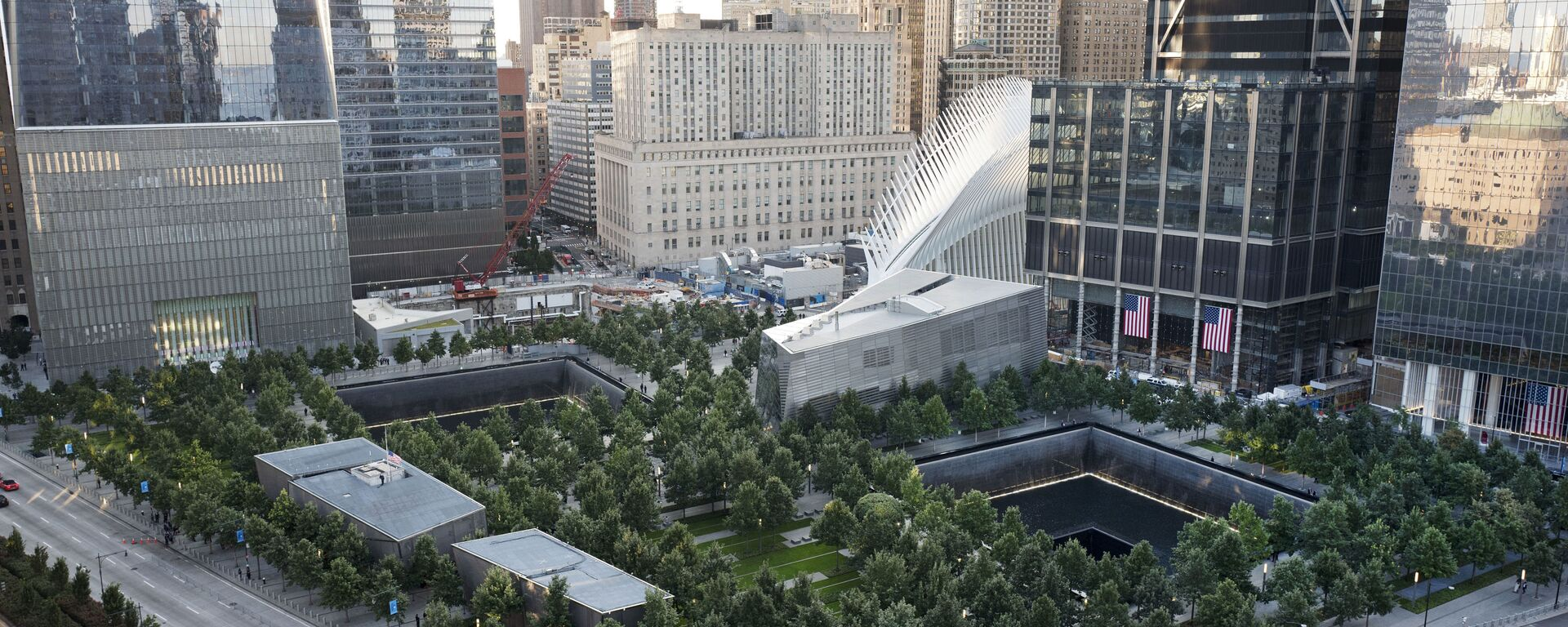 The National September 11 Memorial and Museum are set for a memorial service, Monday, Sept. 11, 2017, in New York. Thousands of 9/11 victims' relatives, survivors, rescuers and others are expected to gather Monday at the World Trade Center to remember the deadliest terror attack on American soil. Nearly 3,000 people died when hijacked planes slammed into the trade center, the Pentagon and a field near Shanksville, Pa., on Sept. 11, 2001.  - Sputnik International, 1920, 08.09.2021
