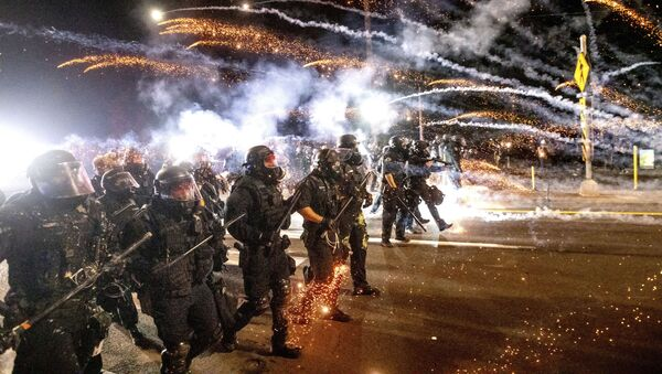 Police use chemical irritants and crowd control munitions to disperse protesters during a demonstration in Portland, Ore., Saturday, Sept. 5, 2020 - Sputnik International