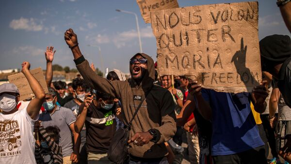 Refugees and migrants from the Moria camp protest near Mytilene on the Greek island of Lesbos, on September 12, 2020, a few days after a fire destroyed the Moria refugee camp - Sputnik International