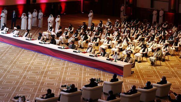 Delegates attend talks between the Afghan government and Taliban insurgents in Doha - Sputnik International