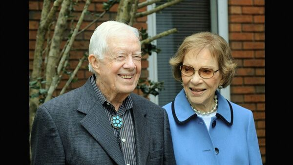 In this image from video, former President Jimmy Carter and former first lady Rosalynn Carter, seen in a photo as they speak on audio only, during the second night of the Democratic National Convention on Tuesday, Aug. 18, 2020.  - Sputnik International