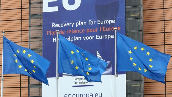 European Union flags flutter outside the European Commission headquarters, ahead of an EU leaders summit at the European Council headquarters, in Brussels, Belgium July 16, 2020. - Sputnik International