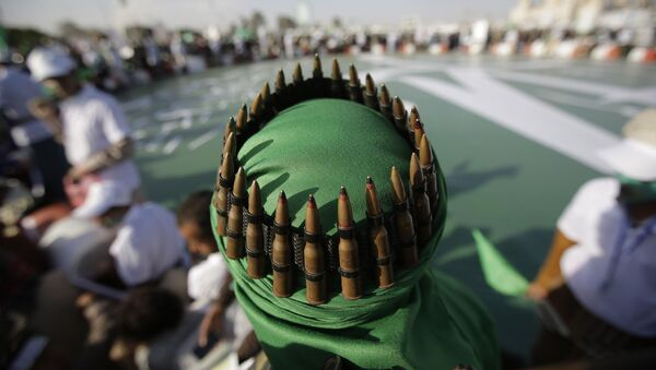 A supporter of Shiite rebels, known as Houthis, with an ammunition belt placed on his head attends a celebration of Moulid al-nabi, the birth of Islam's prophet Muhammad in Sanaa, Yemen, Saturday, Nov. 9, 2019 - Sputnik International