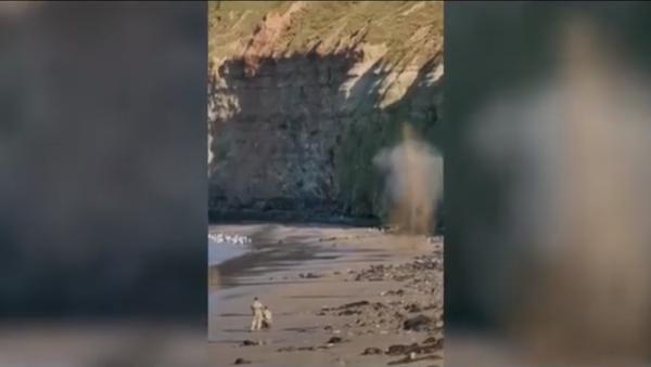 Screenshot from a video showing a bomb disposal team detonating an old grenade in Cat Nab, Saltburn, UK - Sputnik International