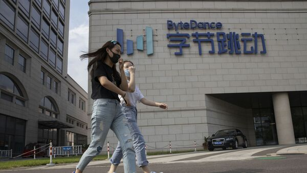 Women wearing masks to prevent the spread of the coronavirus chat as they pass by the ByteDance headquarters in Beijing, China on Friday, Aug. 7, 2020. President Donald Trump on Thursday ordered a sweeping but unspecified ban on dealings with the Chinese owners of consumer apps TikTok and WeChat, although it remains unclear if he has the legal authority to actually ban the apps from the U.S. TikTok is owned by Chinese company ByteDance - Sputnik International