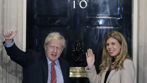 In this Friday, 13 December 2019 file photo, Britain's Prime Minister Boris Johnson and his partner Carrie Symonds wave from the steps of number 10 Downing Street in London. - Sputnik International
