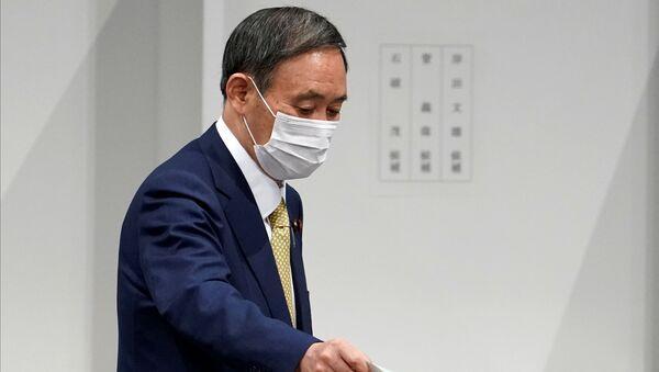 Japanese Chief Cabinet Secretary Yoshihide Suga casts his ballot at the Liberal Democratic Party's (LDP) leadership election in Tokyo, Japan September 14, 2020.  - Sputnik International