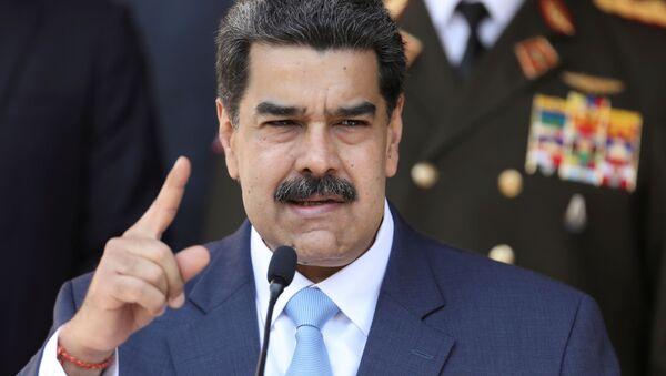 Venezuela's President Nicolas Maduro speaks during a news conference at Miraflores Palace in Caracas, Venezuela, March 12, 2020 - Sputnik International