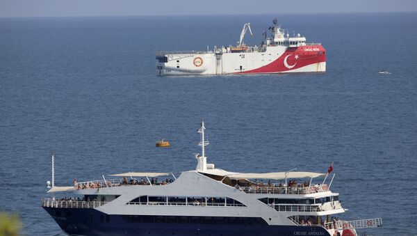 Turkey's research vessel, Oruc Reis, rear, anchored off the coast of Antalya on the Mediterranean, Turkey, Sunday, Sept. 13, 2020. Greece's Prime Minister Kyriakos Mitsotakis welcomed the return of a Turkish survey vessel to port Sunday from a disputed area of the eastern Mediterranean that has been at the heart of a summer stand-off between Greece and Turkey over energy rights. - Sputnik International