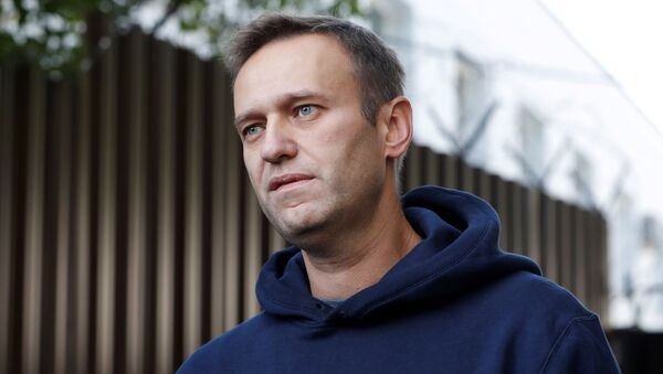 Russian opposition leader Alexei Navalny speaks with journalists after he was released from a detention centre in Moscow, Russia August 23, 2019 - Sputnik International