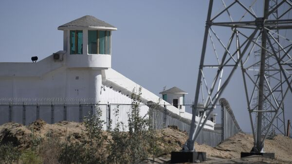This file photo taken on May 30, 2019 shows watchtowers on a high-security facility near what is believed to be a re-education camp where mostly Muslim ethnic minorities are detained, on the outskirts of Hotan, in China's northwestern Xinjiang region. - The US announced September 14, 2020 it would block a range of Chinese products made by forced labor in the Xinjiang region, including from a vocational center that it branded a concentration camp for Uighur minorities. - Sputnik International