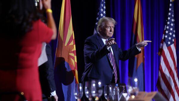 U.S. President Donald Trump gestures during a campaign event at the Arizona Grand Resort and Spa in Phoenix, Arizona U.S., September 14, 2020. - Sputnik International