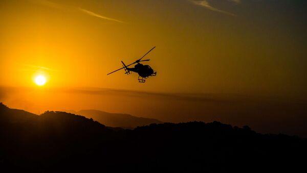 Helicopter sunset - Sputnik International