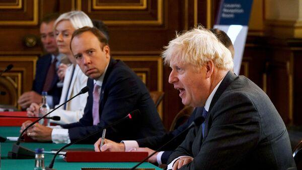 British Health Secretary Matt Hancock looks on as Prime Minister Boris Johnson speaks at a cabinet meeting at the Foreign Office in London, Britain September 15, 2020 - Sputnik International