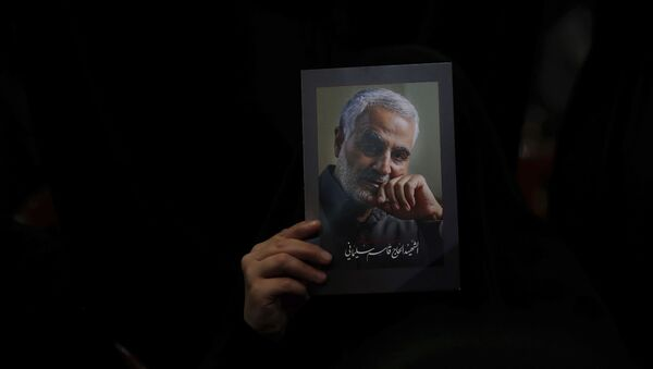 A Hezbollah supporter holds pictures of slain Iranian Revolutionary Guard Gen. Qassem Soleimani during a ceremony marking the anniversary of the assassination of Hezbollah leaders, Abbas al-Moussawi, Ragheb Harb and Imad Mughniyeh and the end of a 40-day Muslim mourning period for Soleimani, in the southern suburb of Beirut, Lebanon, Sunday, Feb. 16, 2020. Nasrallah said U.S. President Donald Trump declared war on the Middle East when the U.S. assassinated Soleimani and when the White House announced its plan to end the Palestinian-Israeli conflict. He called on all to resist U.S. influence and its troops presence. - Sputnik International