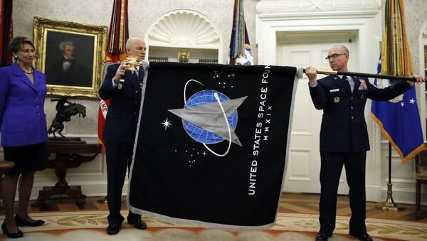 Chief of Space Operations at US Space Force Gen. John Raymond, center, and Chief Master Sgt. Roger Towberman, right, hold the United States Space Force flagas it is presented in the Oval Office of the White House, Friday, May 15, 2020, in Washington.  Secretary of the Air Force Barbara Barrett stands far left. - Sputnik International