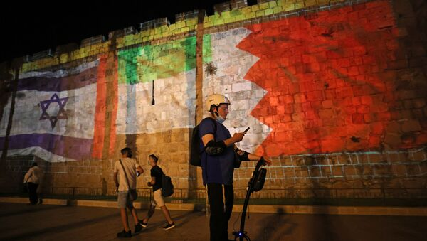 The flags of Israel, United Arab Emirates, and Bahrain are projected on the ramparts of Jerusalem's Old City on September 15, 2020 in a show of support for Israeli normalisation deals with the United Arab Emirates and Bahrain - Sputnik International