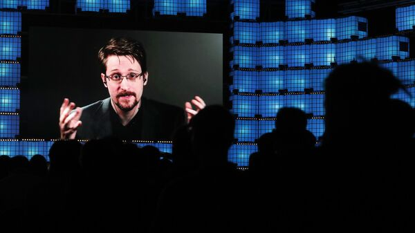 Former U.S. National Security Agency contractor Edward Snowden addresses attendees through video link at the Web Summit technology conference in Lisbon, Monday, Nov. 4, 2019 - Sputnik International