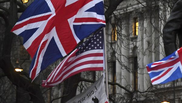 In this file photo dated Friday, Jan. 31, 2020, Brexit supporters hold British and US flags during a rally in London - Sputnik International