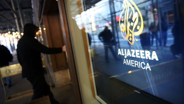 NEW YORK, NY - JANUARY 13: The logo for Al Jazeera America is displayed outside of the cable news channel's offices on January 13, 2016 in New York City. Al Jazeera America, which debuted in August 2013, announced today that they are shutting down. - Sputnik International