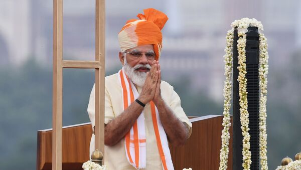 India's Prime Minister Narendra Modi gestures after unfurling the tricolour during a ceremony to celebrate India's 74th Independence Day, which marks the end of British colonial rule, at the Red Fort in New Delhi on August 15, 2020 - Sputnik International