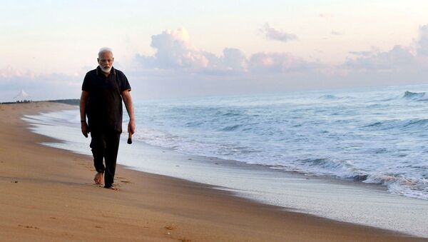 In this photo provided by Prime Minister of India Narendra Modi's twitter handle, Indian Prime Minister Narendra Modi takes morning walk at a beach in Mamallapuram, in southern India, Saturday, Oct. 12, 2019 - Sputnik International