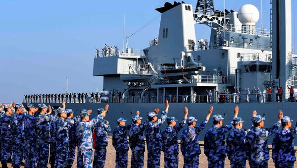 Soldiers of the Chinese People's Liberation Army (PLA) Navy take part in a ceremony as a replenishment ship sets sail to the Gulf of Aden and the waters off Somalia, from a naval port in Qingdao, Shandong province, China September 3, 2020 - Sputnik International
