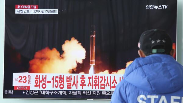 A man watches a TV screen showing what the North Korean government calls the Hwasong-15 intercontinental ballistic missile, at the Seoul Railway Station in Seoul, South Korea, Thursday, Nov. 30, 2017 - Sputnik International
