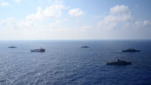 In this photo provided by the Turkish Defense Ministry, Turkey's research vessel, Oruc Reis, in red and white, is surrounded by Turkish navy vessels as it was heading in the west of Antalya on the Mediterranean, Turkey, Monday, Aug 10, 2020 - Sputnik International