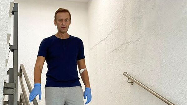 Russian opposition politician Alexei Navalny goes downstairs at Charite hospital in Berlin, Germany, in this undated image obtained from social media September 19, 2020 - Sputnik International