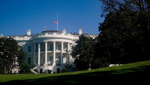 The American flag above the White House is seen at half staff after the death of Supreme Court Justice Ruth Bader Ginsburg, in Washington, U.S. September 20, 2020. - Sputnik International