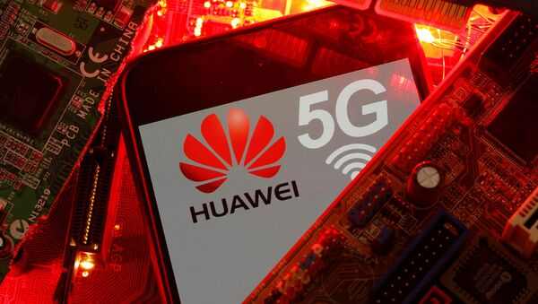 A smartphone with the Huawei and 5G network logo is seen on a PC motherboard in this illustration picture taken January 29, 2020 - Sputnik International