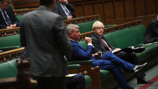 Britain's Prime Minister Boris Johnson looks on during a PM's statement session on the coronavirus disease (COVID-19) in the House of Commons, in London, Britain September 22, 2020.  - Sputnik International