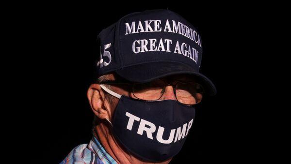 A man wearing a Make America Great Again hat attends U.S. President Donald Trump's campaign rally in Reno, Nevada, U.S., September 12, 2020. - Sputnik International