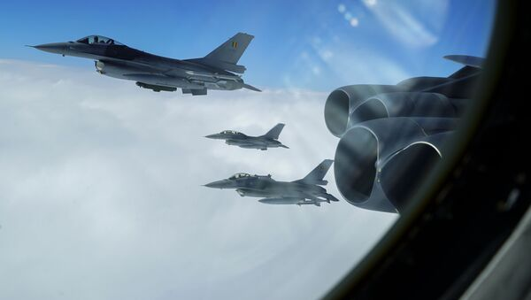 Belgian F-16A Fighting Falcons join up in formation alongside a B-52H Stratofortress, assigned to the 5th Bomb Wing at Minot Air Force Base, North Dakota, during the Bomber Task Force Europe mission, Allied Sky, on Aug. 28, 2020. Allied Sky was a single-day mission overflying 30 NATO nations and part of the routine Bomber Task Force missions that have occurred in the European theater of operations since 2018 with more than 200 sorties coordinated with Allies and partners. - Sputnik International