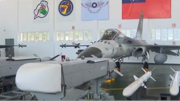 Taiwan's indigenously-made Wan Chien cruise missiles and US-made AGM-84 Harpoon anti-ship missiles on display in front of an F-CK-1C/D Indigenous Defense Fighter at Makung Air Force Base on September 22, 2020 - Sputnik International