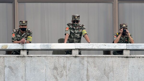 North Korean soldiers keep watch toward the south as South Korean Unification Minister Lee In-young inspects (not pictured) the truce village of Panmunjom inside the demilitarized zone separating the two Koreas, South Korea, September 16, 2020 - Sputnik International