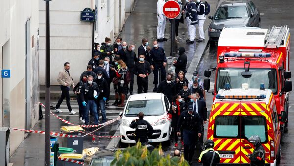 General view as police officers investigate the scene of an incident near the former offices of French magazine Charlie Hebdo, in Paris, France, 25 September 2020 - Sputnik International