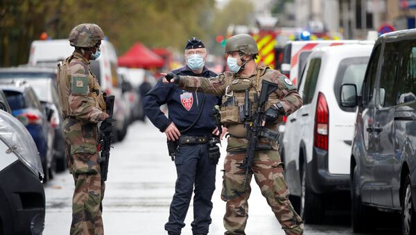 Security forces guard the scene of an incident near the former offices of French magazine Charlie Hebdo, in Paris, France September 25, 2020 - Sputnik International