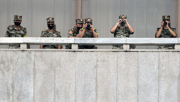 North Korean soldiers keep watch toward the south as South Korean Unification Minister Lee In-young inspects (not pictured) the truce village of Panmunjom inside the demilitarised zone separating the two Koreas, South Korea, 16 September 2020. - Sputnik International