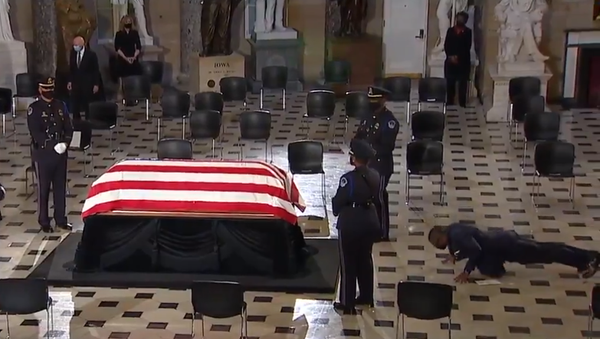 Screenshot from a video showing personal trainer of Justice Ruth Bader Ginsburg doint push-ups in her memory while standing in front of her casket during the memorial service in US Capitol - Sputnik International