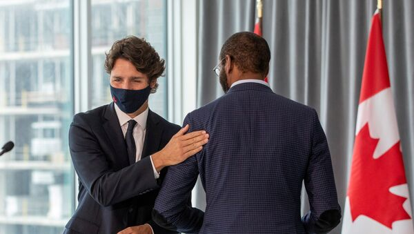 Canada's Prime Minister Justin Trudeau pats member of parliament Greg Fergus, after unveiling plans for post-coronavirus recovery for Black owned business and entrepreneurs in Toronto, Ontario, Canada September 9, 2020. - Sputnik International