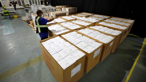 An election worker surveys thousands of absentee ballots awaiting preparation at the Wake County Board of Elections on the first day that the state started mailing out absentee ballots, in Raleigh, North Carolina, U.S. September 4, 2020.  - Sputnik International