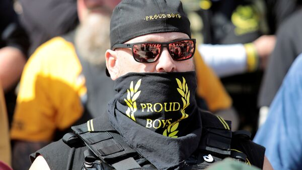 An armed member of the 'Proud Boys' attends a '2nd Amendment' rally outside the Michigan Supreme Court Building in Lansing, Michigan, US 17 September 2020. - Sputnik International