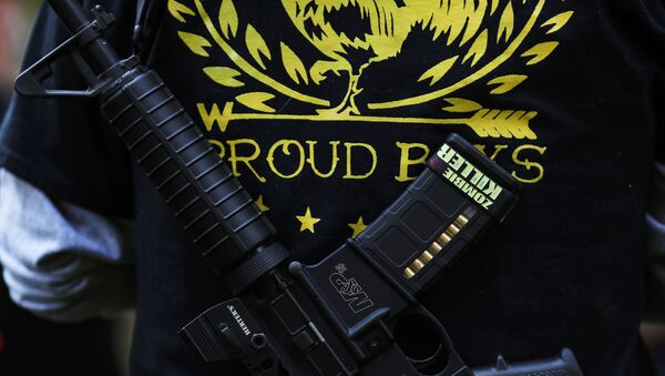 A Proud Boy carries a gun during a gathering at a local park to remember Patriot Prayer supporter Aaron J. Danielson, who was shot dead in Portland, Oregon after street clashes between supporters of President Donald Trump and counter-demonstrators, in Vancouver, Washington, U.S. September 5, 2020. - Sputnik International